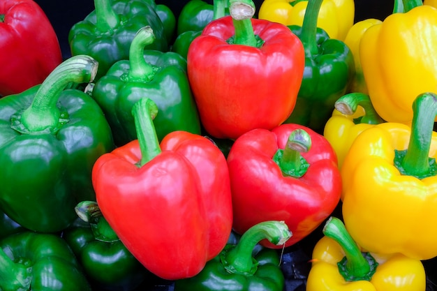 Close-up fresh green and yellow bell pepper(sweet pepper or capsicum) on fresh market