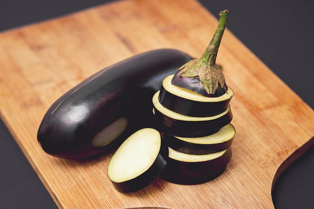 Close up of fresh healthy whole and sliced eggplants.