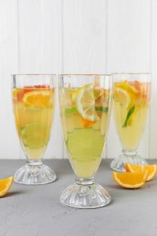 Close up fresh lemonade glasses