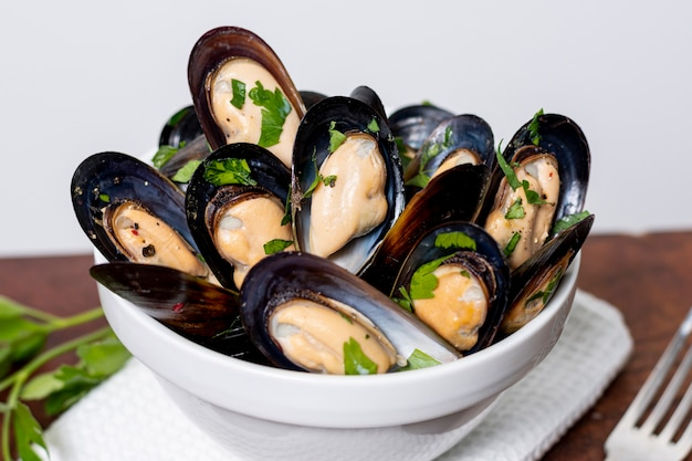 Close-up fresh mussel shells with parsley