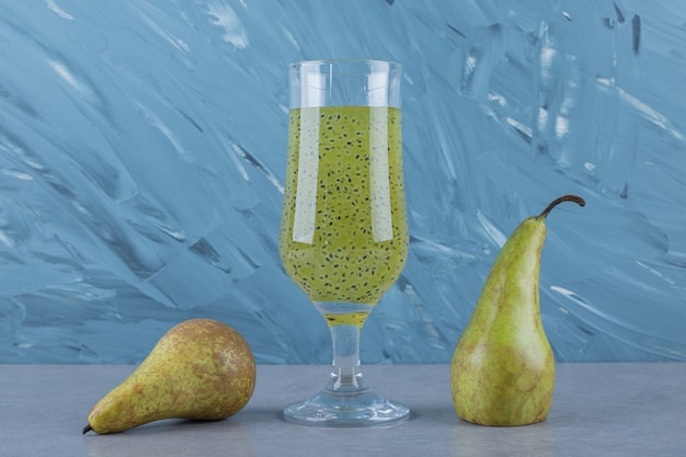 Close up of fresh pears and juice on grey surface