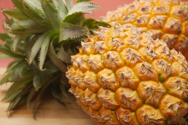 Close up of fresh pineapple in bowl on table