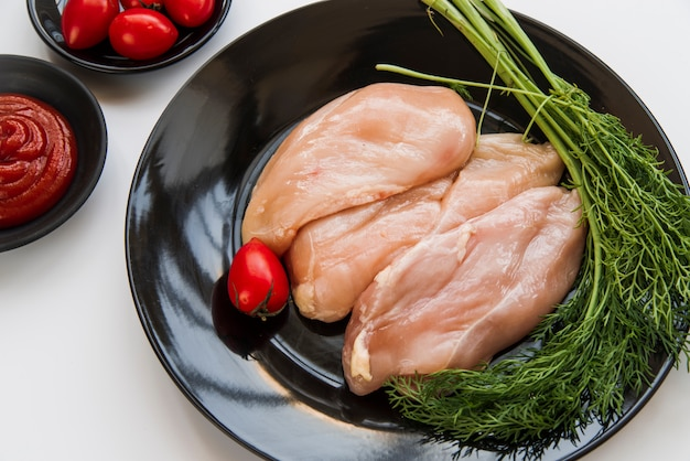 Close-up of fresh raw chicken and ingredients