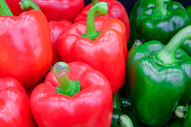 Close-up fresh red and green bell pepper (sweet pepper or capsicum) on fresh market
