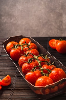 Close-up of fresh red tomatoes in tray