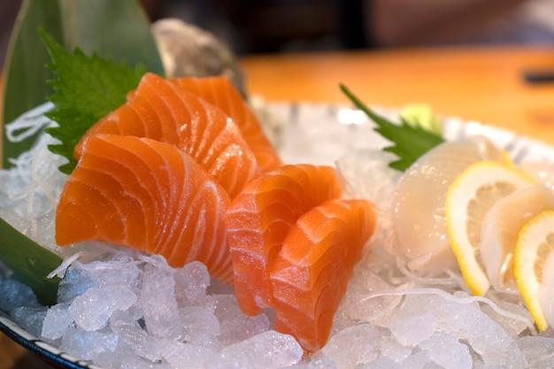 Close up fresh salmon sashimi or salmon slice on ice