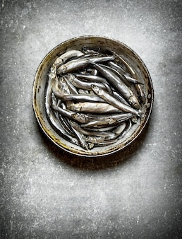 Close up on fresh sprat in the old pan