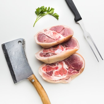 Close-up fresh steaks with knife on the table