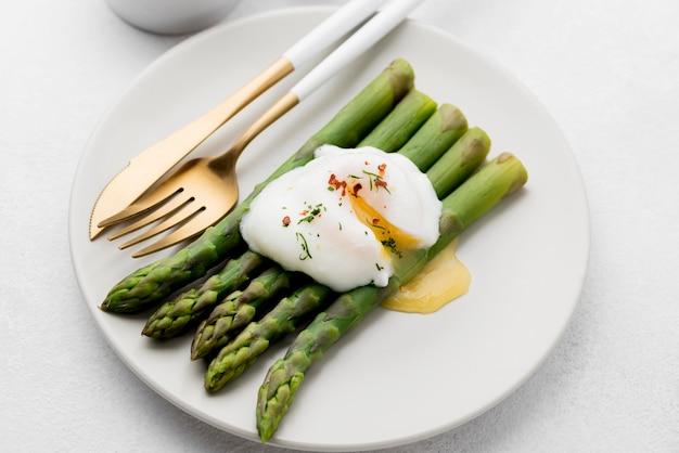 Close-up fried egg with asparagus