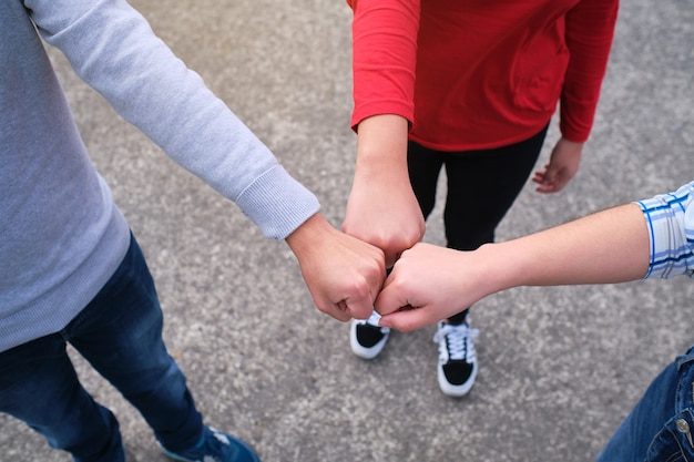 Close-up of friends making a fist bump gesture