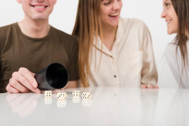 Close-up friends playing yahtzee