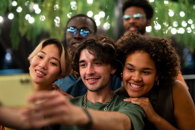 Close up friends taking selfie together