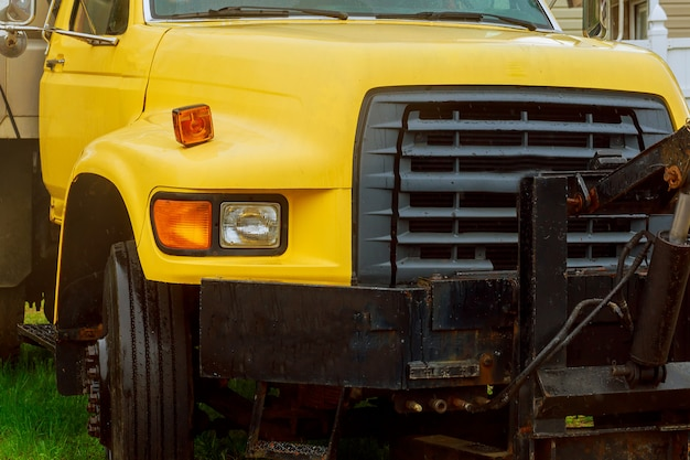 Close up front view of yellow truck,