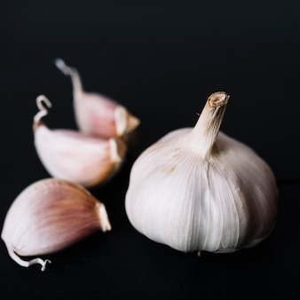 Close-up of garlic bulb on black background