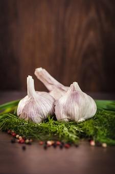 Close up of garlic on green herbs
