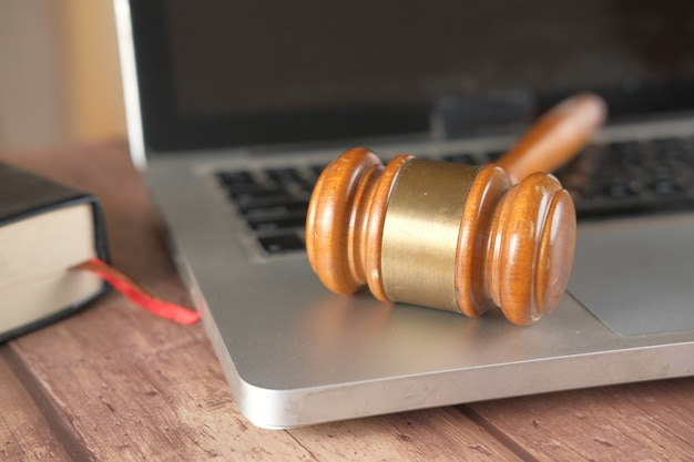 Close up of a gavel on laptop on table