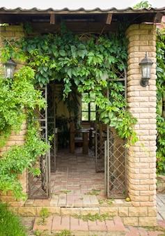 Close-up of gazebo with stylish garden furniture.