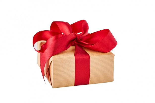 Close up gift box in craft paper with red ribbon isolated