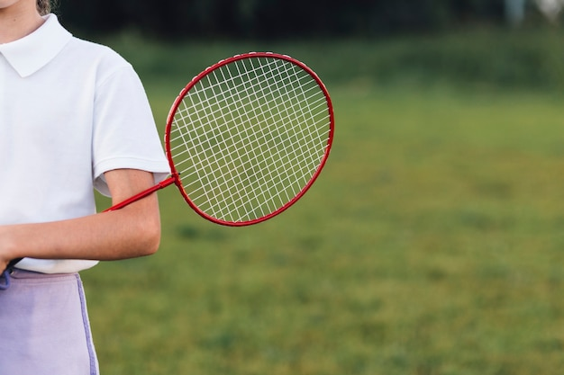 Close-up of a girl holding badminton in the park