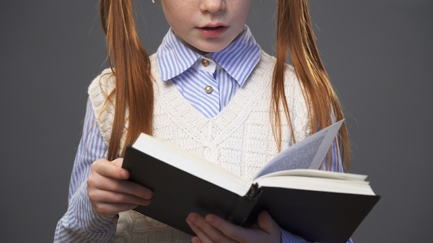 Close up girl holding a book
