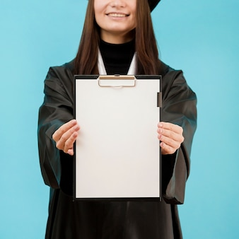 Close-up girl holding clipboard