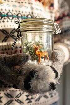 Close-up girl holding jar with deer