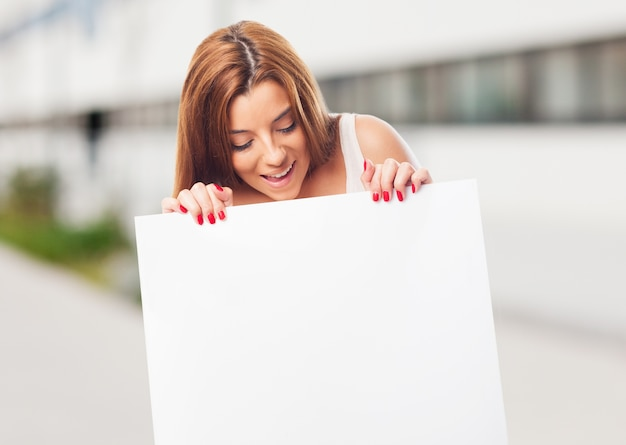 Close up of girl holding white board