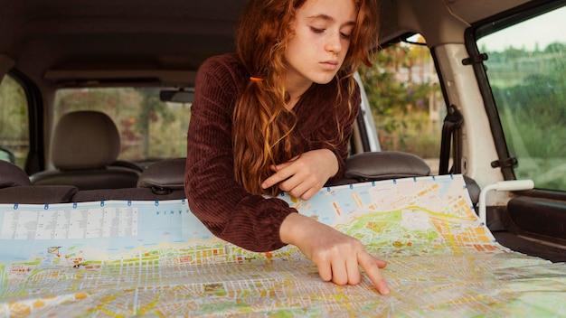 Close-up girl looking at map