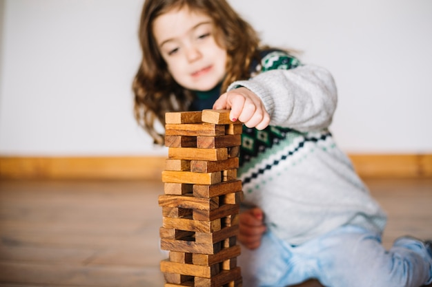 Close-up of a girl playing jenga game