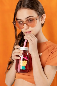 Close up girl posing with drink