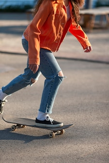 Close up girl on skateboard
