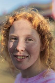 Close-up girl smiling at the camera