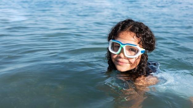 Close up girl swimming