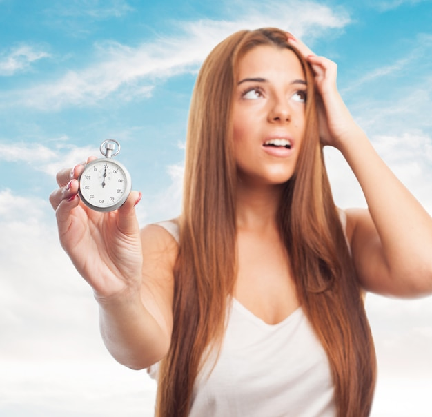 Close-up of girl with stopwatch