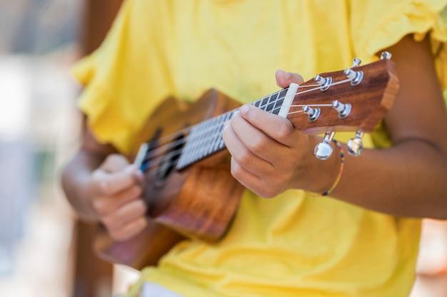 Close up of girl with ukulele