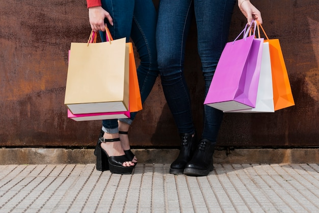 Close-up of girls holding shopping bags