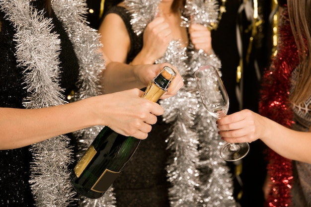 Close up of girls with champagne at new year party