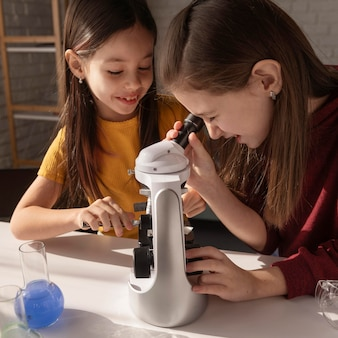 Close up girls working with microscope