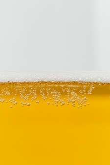 Close-up glass of beer with foam