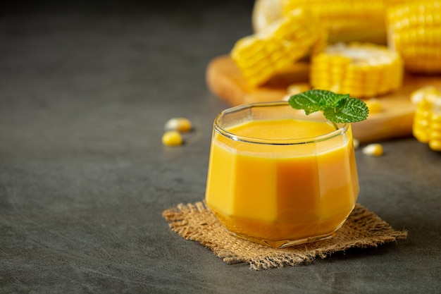 Close up on glass of corn juice ready to eat