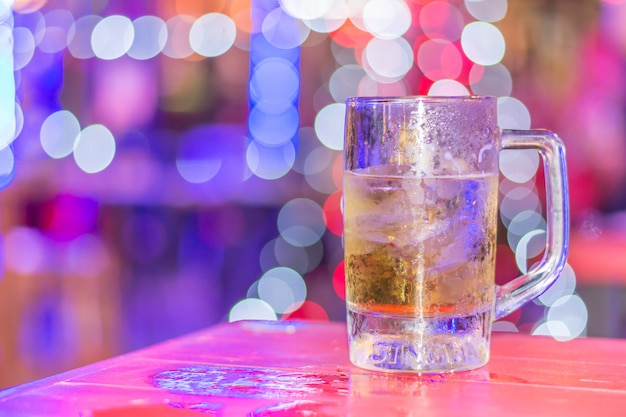 Close-up glass of liquor on table bokeh blurred background
