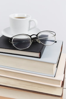 Close up of glasses on books