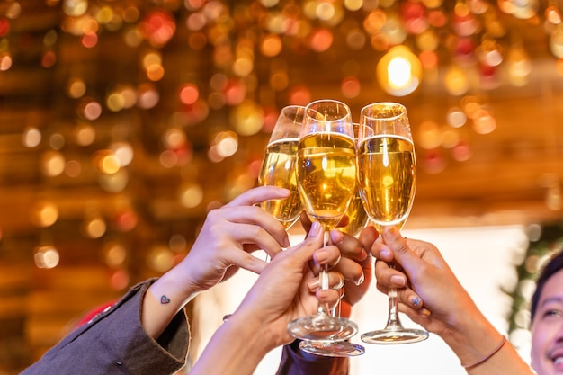 Close up glasses of clinking glasses of champagne with lighting party with drinking of champagne