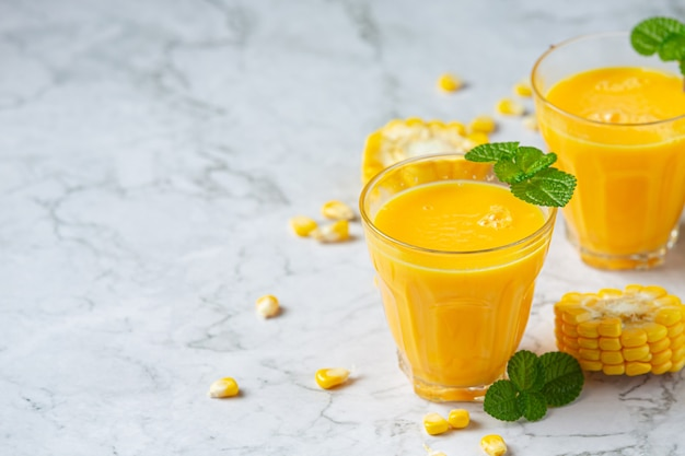 Close up on glasses of corn juice ready to eat