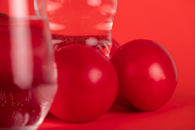 Close-up glasses of water and tomatoes