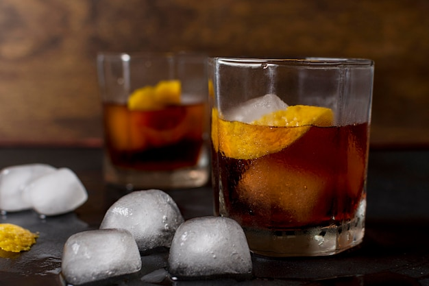 Close-up glasses of whiskey with ice
