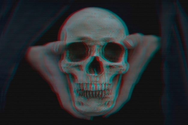 Close-up of glitched skull held in hands