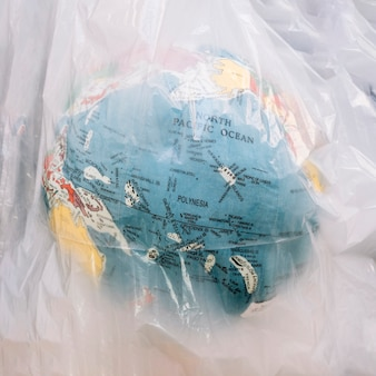 Close-up of a globe inside transparent plastic bag
