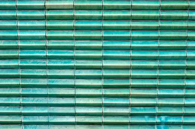 Close up glossy turquoise green tile color structure layer block