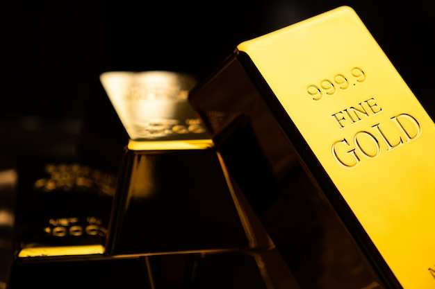Close up of gold bars on black bacground. financial concept